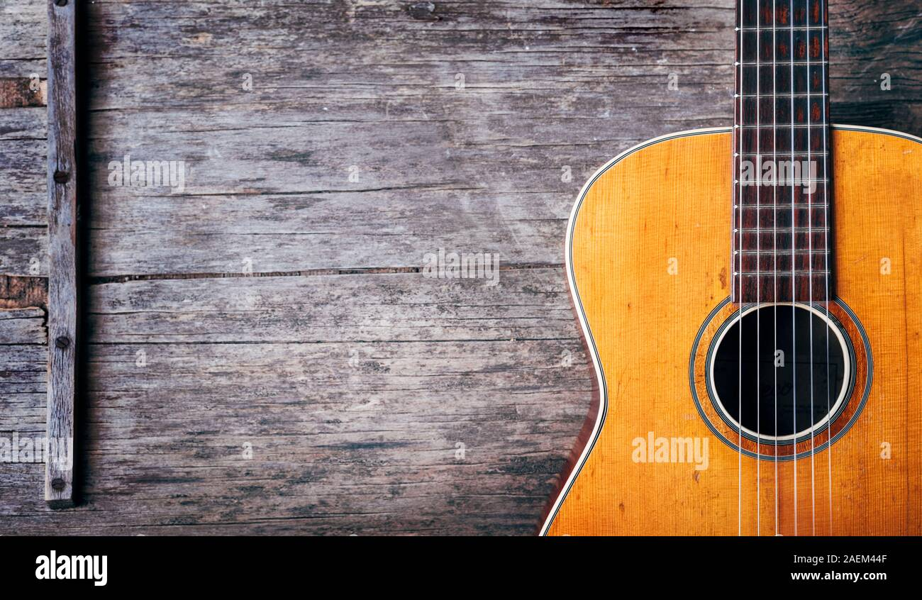 Closeup Of Old Acoustic Spanish Guitar On Rustic Wooden Background From Above Popular Music Tune And Song Design Banner Top View Stock Photo Alamy