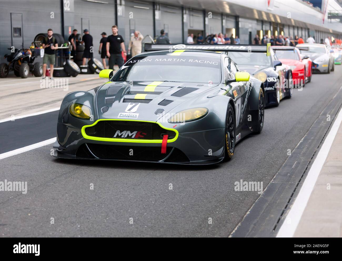 An Aston Martin Vantage V12 Leads A Line Of Race Cars During The Aston Martin Trophy For Masters Endurance Legends At The 2019 Silverstone Classic Stock Photo Alamy