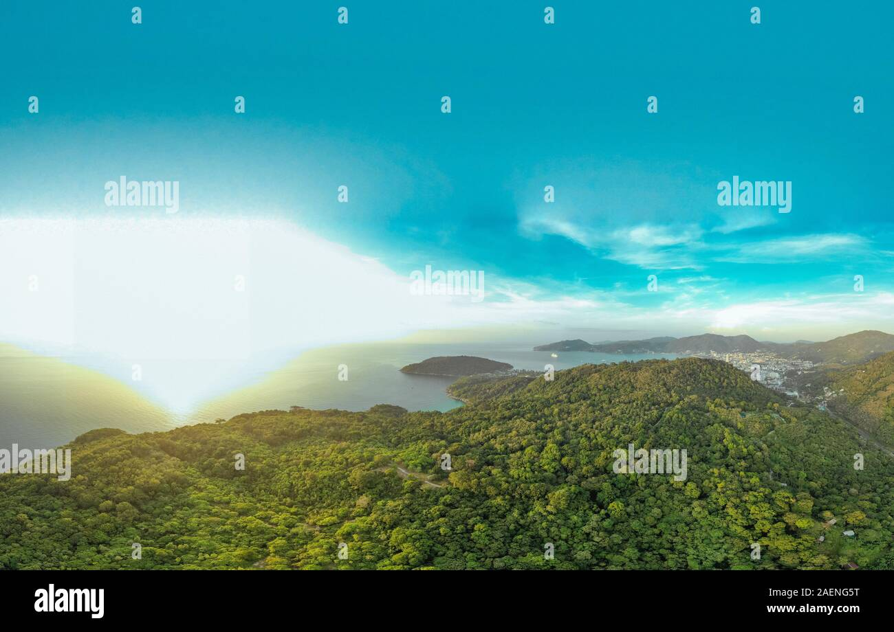 Tropical Forest, Blue Sea and city life in Thailand Phuket Island, Drone flight Stock Photo