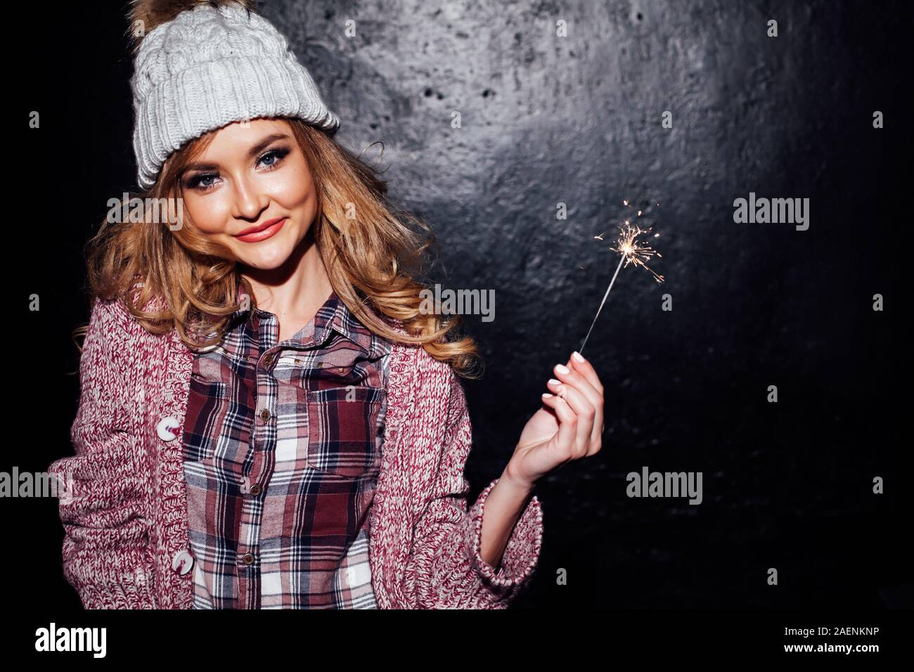 girl on holiday holding sparklers christmas tree Stock Photo