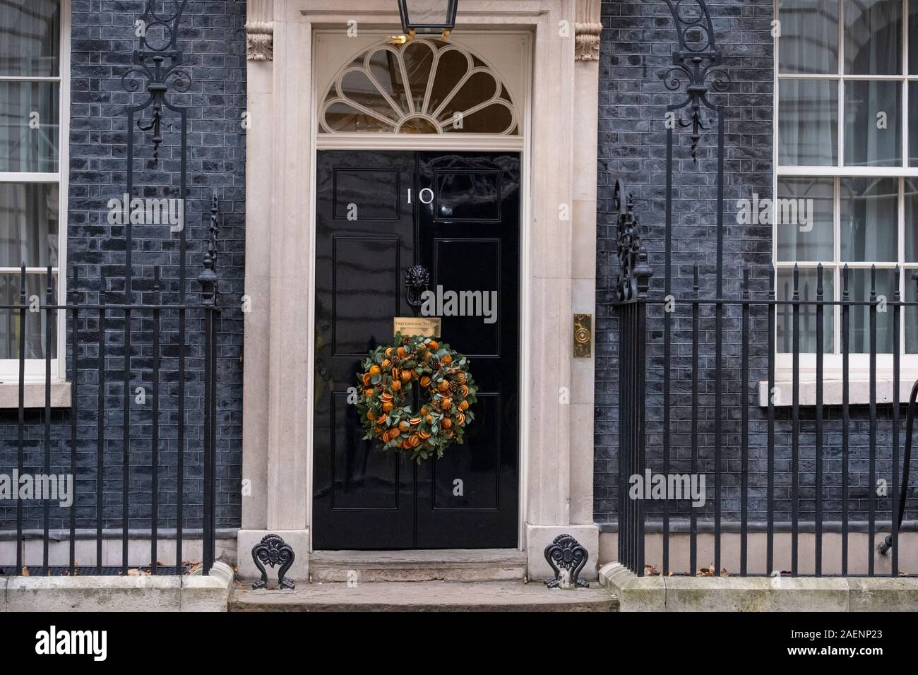 10 Downing Street, London, UK. 10th December 2019. The calm before the storm. A completely quiet Downing Street with festive season decorations, two days before the General Election. Credit: Malcolm Park/Alamy Live News. Stock Photo