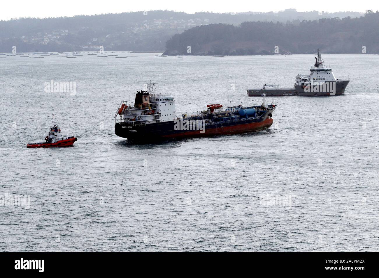 La Coruna, Spain. 10th Dec, 2019. Several tugboats start the transfer to Ferrol, Galicia, of stranded Malta-flagged chemical ship Blue Star in Ares, La Coruna, Spain, 10 December 2019. The ship remained stranded since? 22 November, when it run aground during harsh weather conditions. Credit: EFE News Agency/Alamy Live News Stock Photo