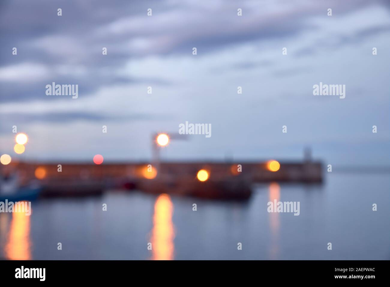 Night view of a fishing port in the north of Spain. out of focus image for background. concept tourism and night Stock Photo
