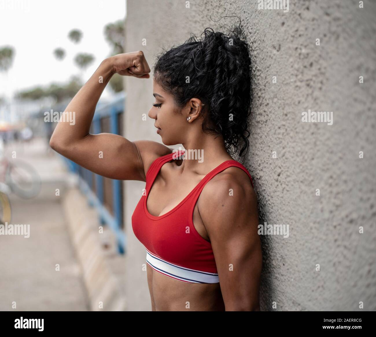 Physically Fit Woman High Resolution Stock Photography And Images Alamy Women are programmed to select healthy male specimens. https www alamy com physically fit woman wearing sports bra flexes arm muscles image336113696 html