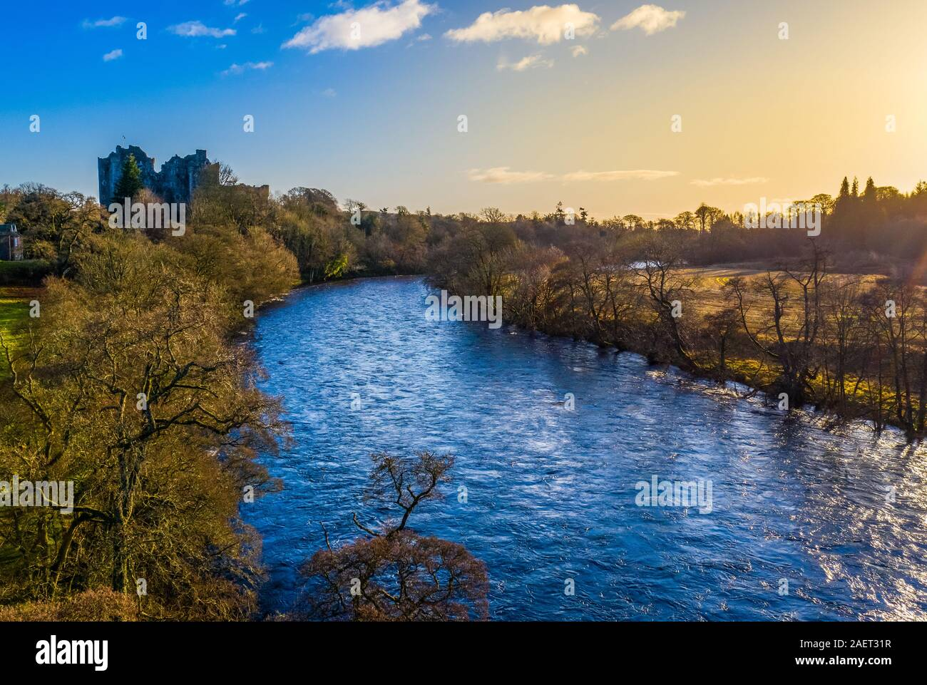 A River And Castle In Scotland In The Beautiful Morning Light Stock Photo
