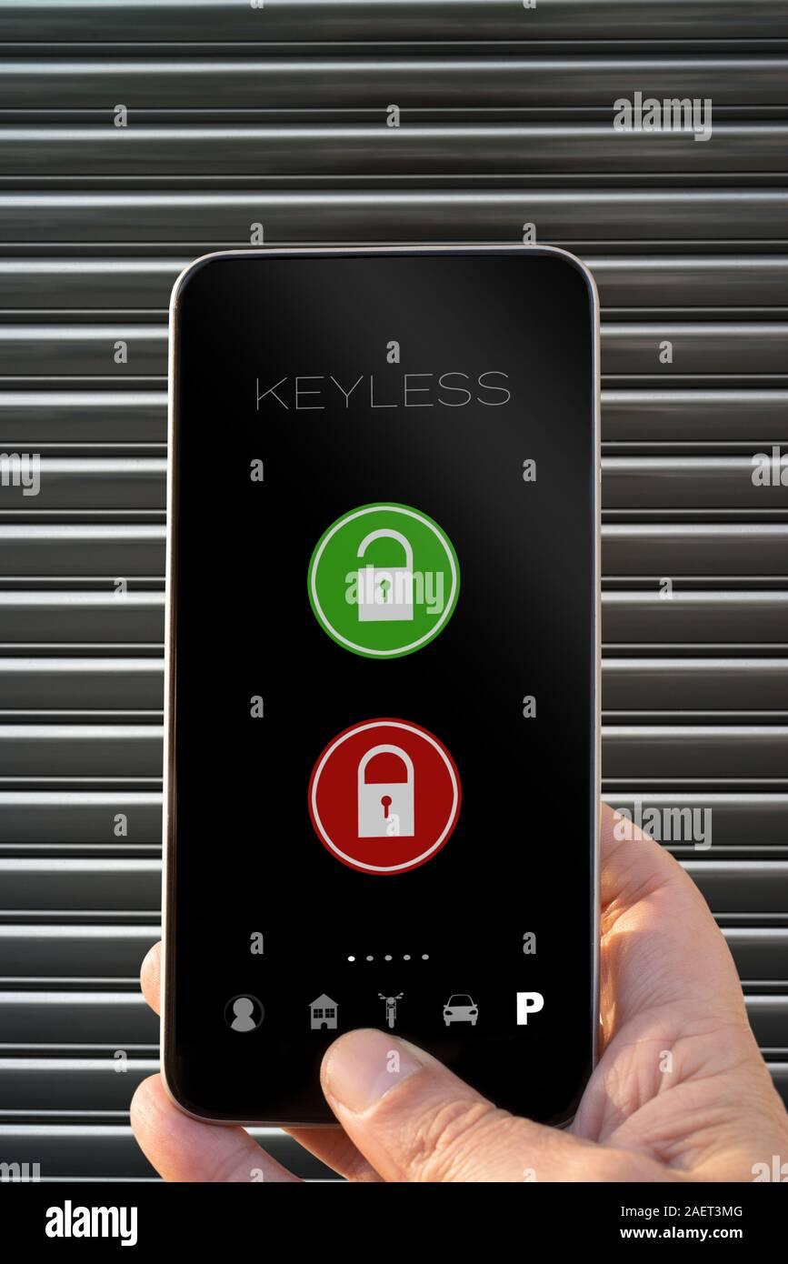 Keyless app smarphone open and close parking door Stock Photo