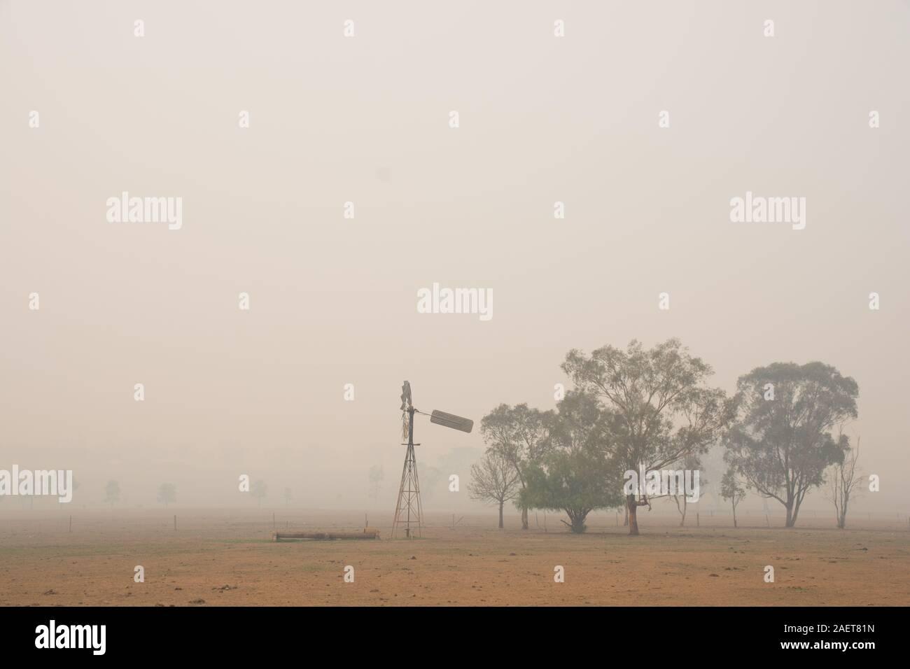 Heavy smoke pollution over a farm from bush fires 120km (70 miles) away.Tamworth Australia. Stock Photo