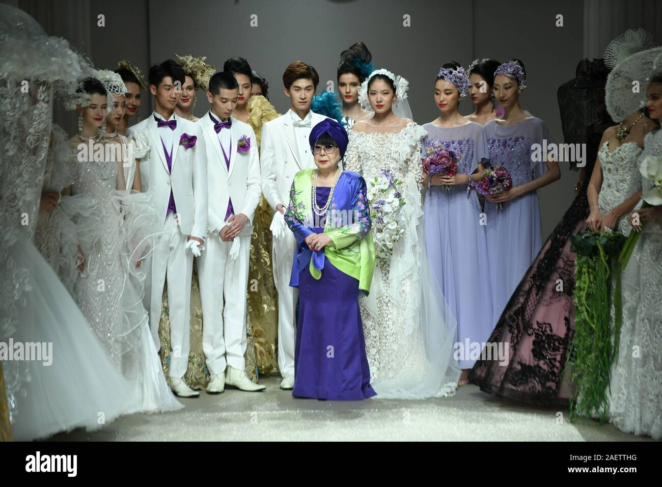 Models And Designer Yumi Katsura Purple Thank The Audience After The Fashion Show In Jinan City East China S Shandong Province 22 November 2019 Stock Photo Alamy