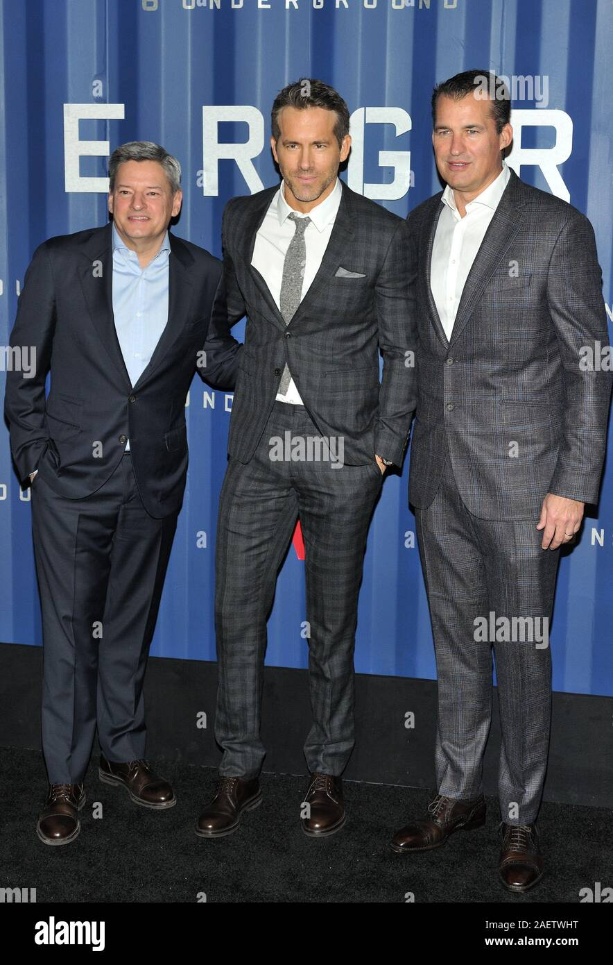 L-R: Netflix exec Ted Sarandos, actor Ryan Reynolds and Netflix exec Scott Stuber attend the NY premiere of 6 Underground at The Shed at Hudson Yards in New York, NY on December 10, 2019.  (Photo by Stephen Smith/SIPA USA) Stock Photo