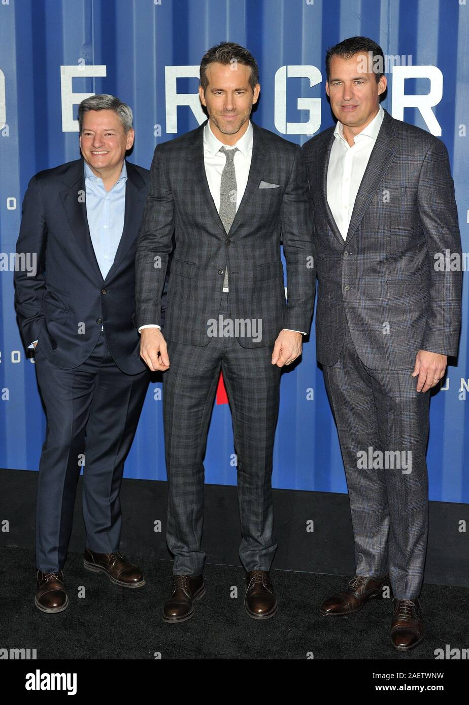 New York, USA. 10th Dec, 2019. L-R: Netflix exec Ted Sarandos, actor Ryan Reynolds and Netflix exec Scott Stuber attend the NY premiere of 6 Underground at The Shed at Hudson Yards in New York, NY on December 10, 2019. (Photo by Stephen Smith/SIPA USA) Credit: Sipa USA/Alamy Live News Stock Photo