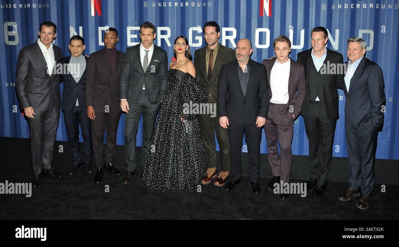 New York, USA. 10th Dec, 2019. L-R: Netflix exec Scott Stuber, actors Payman Maadi, Corey Hawkins, Ryan Reynolds, Adria Arjona, Manuel Garcia-Rulfo, Lior Raz and Ben Hardy, producer David Ellison and Netflix exec Ted Sarandos attend the NY premiere of 6 Underground at The Shed at Hudson Yards in New York, NY on December 10, 2019. (Photo by Stephen Smith/SIPA USA) Credit: Sipa USA/Alamy Live News Stock Photo