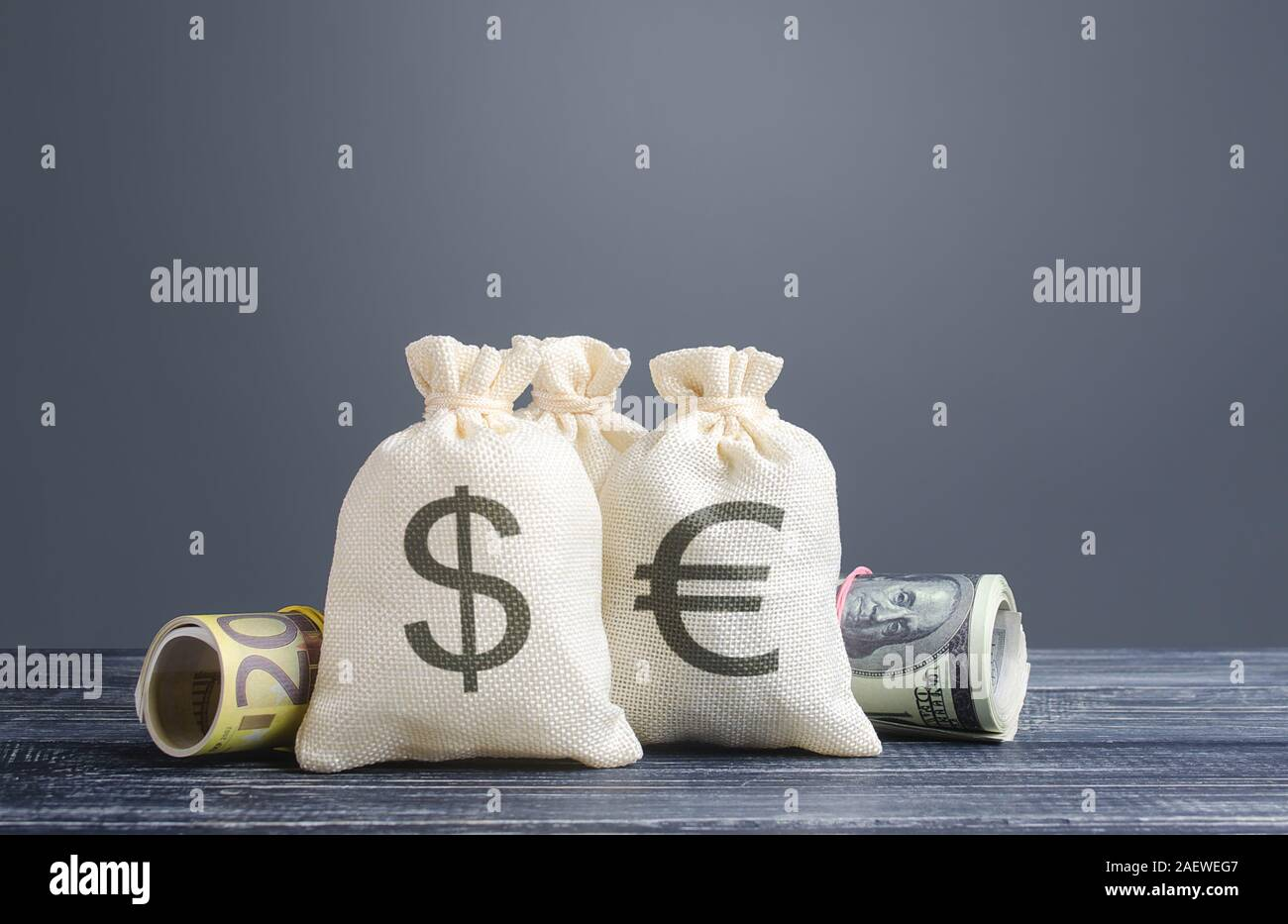 Money bags and world currencies. Capital investment, savings. Economics, lending business. Profit income, dividends payouts. Crowdfunding startups inv Stock Photo