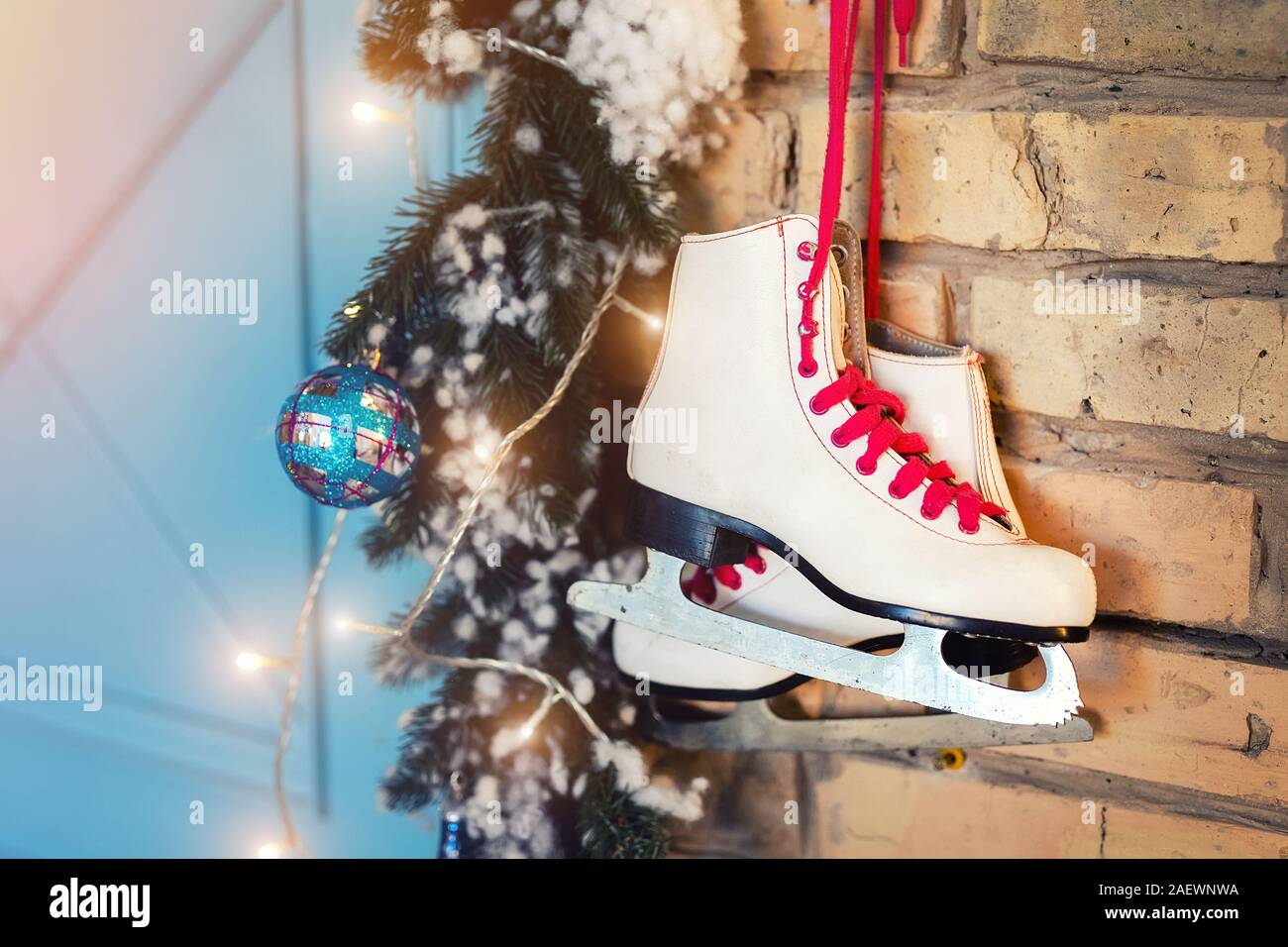 What Can I Use To Attach Christmas Lights To Brick pair of white vintage leather skates with red laces hanging