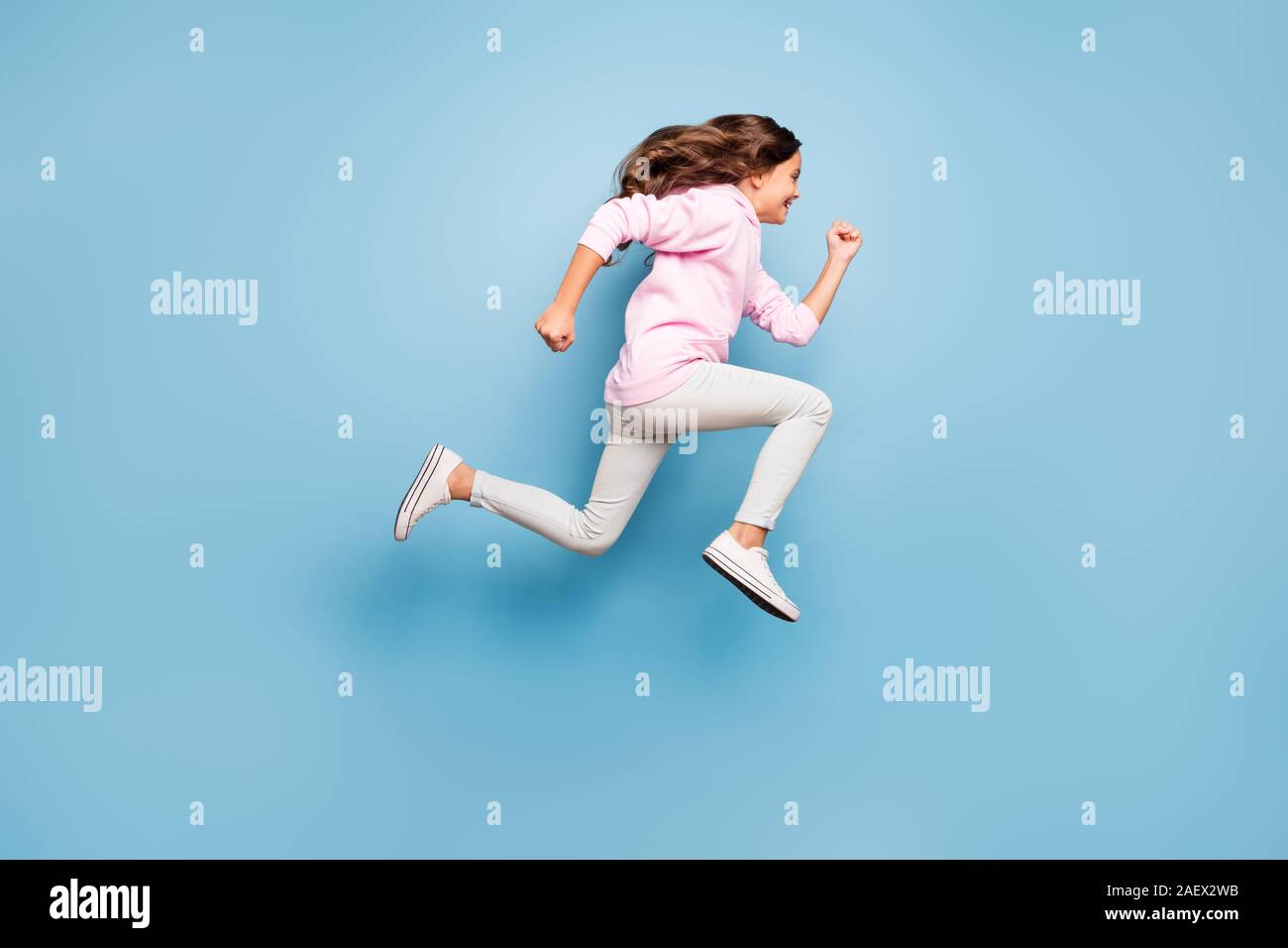 Full length body size photo of cheerful side profile positive crazy excited casual preteen wearing pink pants trousers footwear hurrying for discount Stock Photo