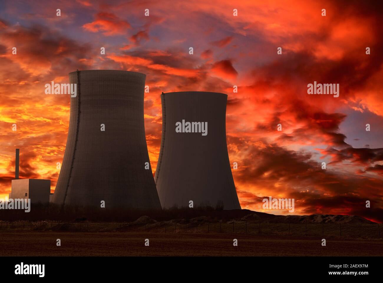 Nuclear power plant with an intense red and cloudy evening sky Stock Photo