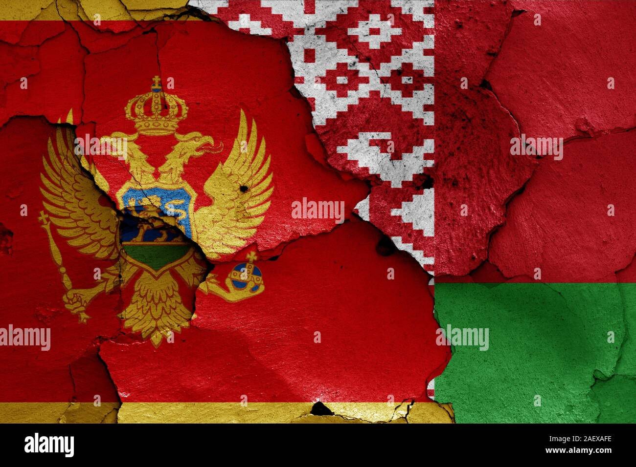 flags of Montenegro and Belarus painted on cracked wall Stock Photo