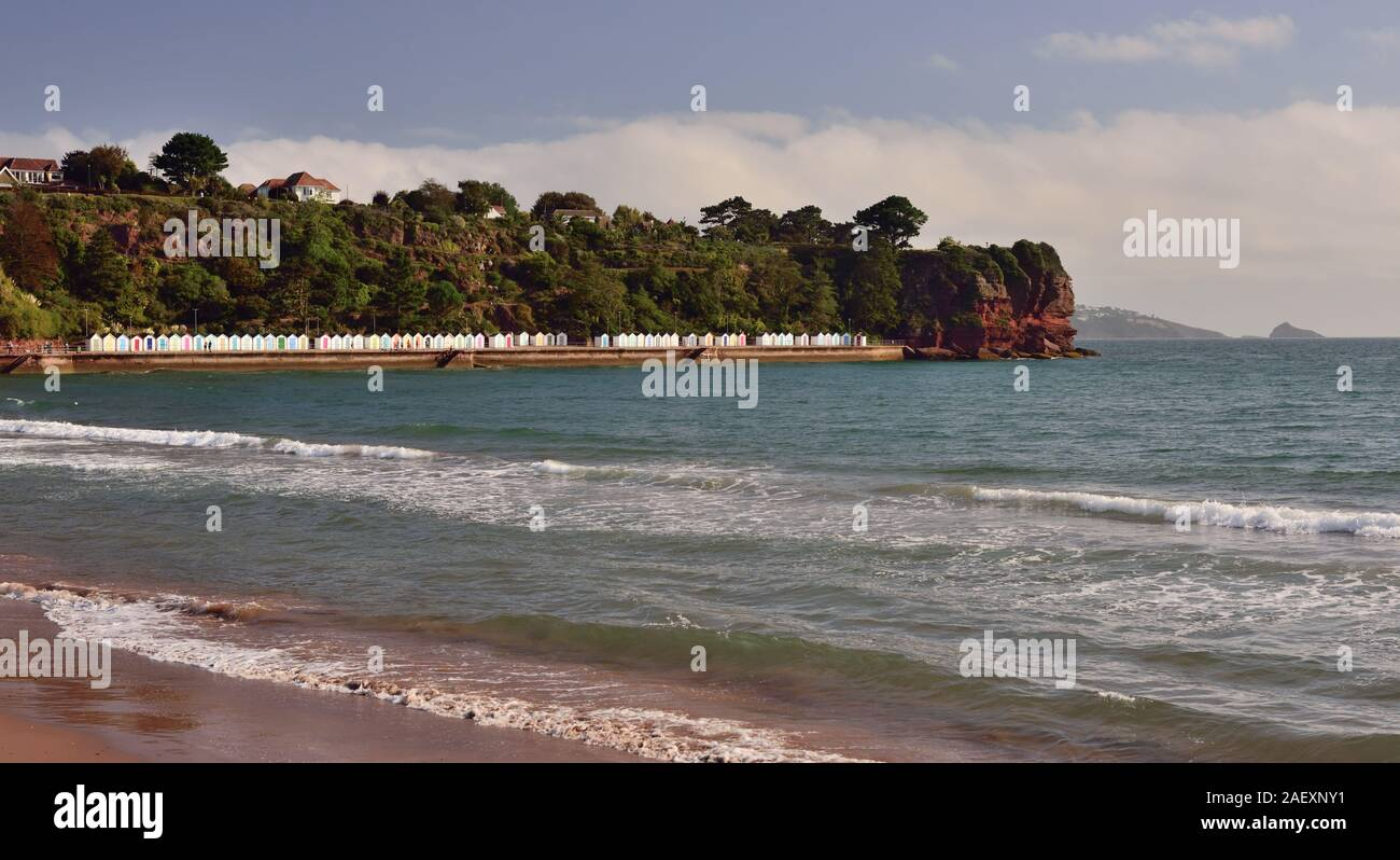 Goodrington beach, and beach huts beneath Roundham Head, Torbay, Devon. Stock Photo