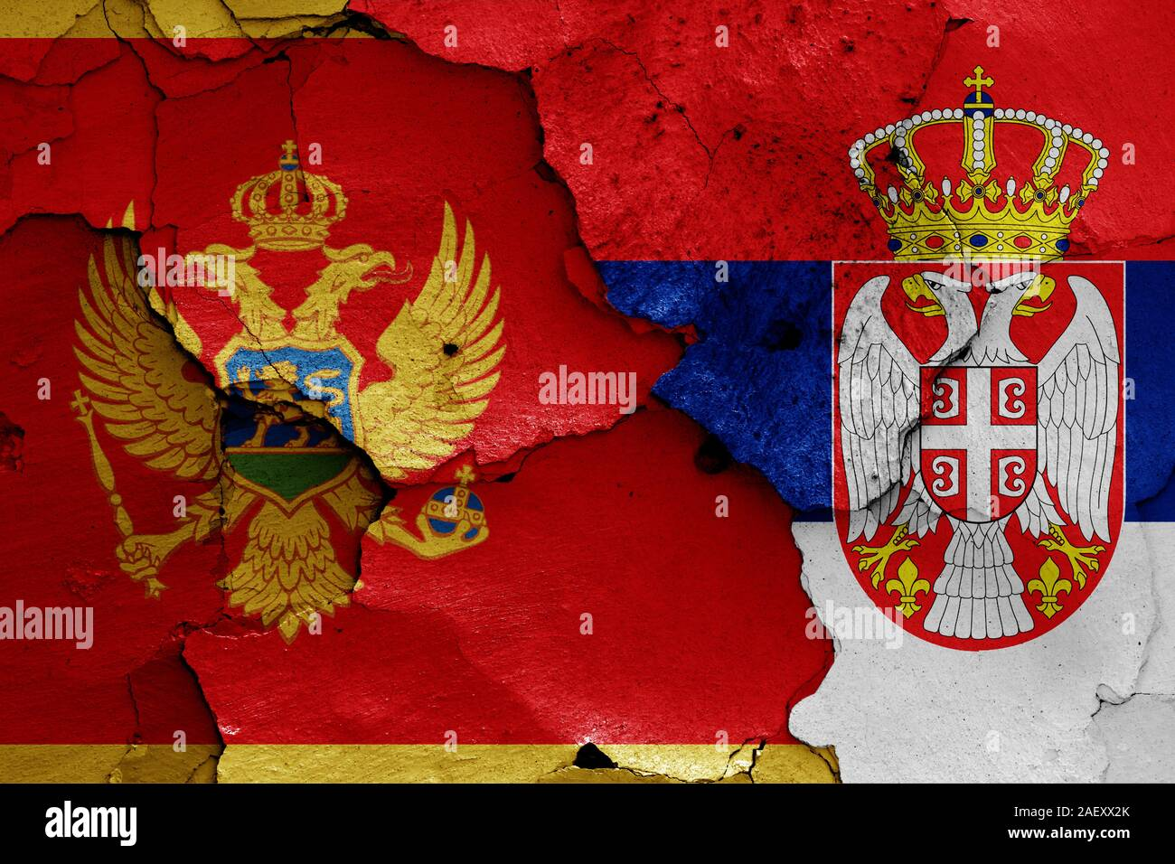 flags of Montenegro and Serbia painted on cracked wall Stock Photo