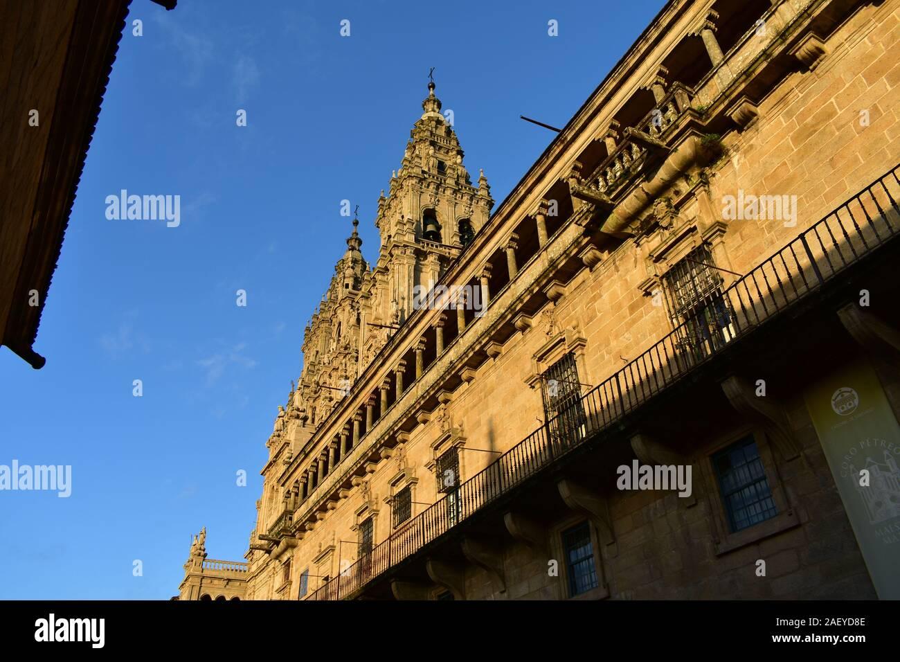 Cathedral with sunset light and blue sky. View from Praza do Obradoiro. Santiago de Compostela, Spain. Stock Photo