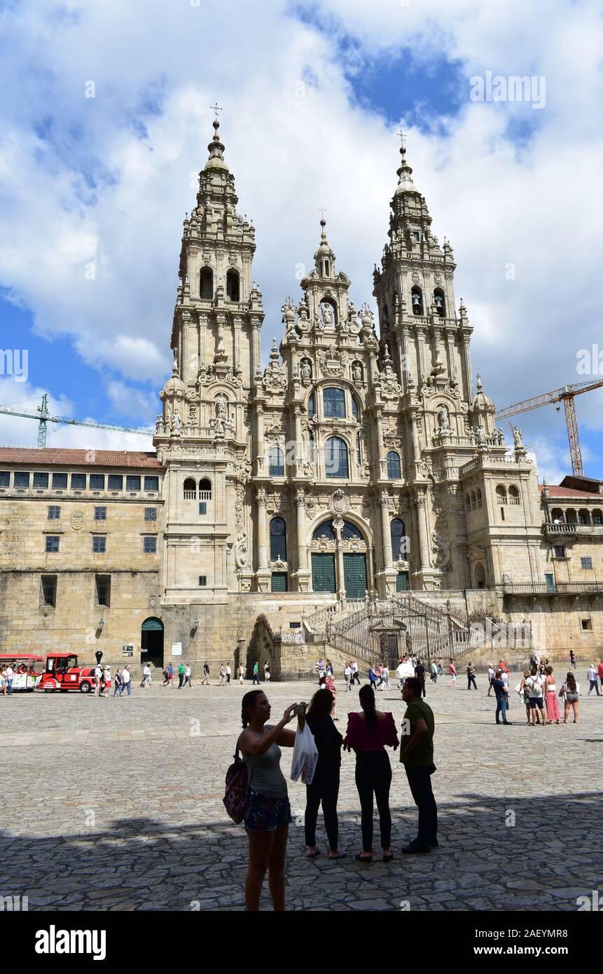 Pilgrims taking pictures in front of Cathedral at Praza do Obradoiro. Santiago de Compostela, Spain. Aug 4, 2019. Stock Photo