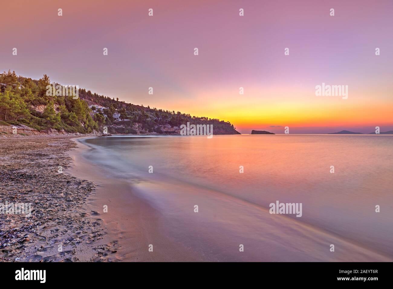 The sunrise at the beach Chrisi Milia of Alonissos island, Greece Stock Photo