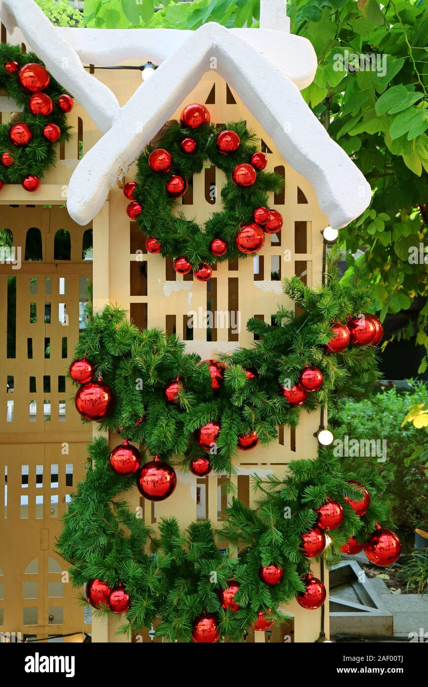 Christmas Decoration with a Doll House in the Garden Stock Photo