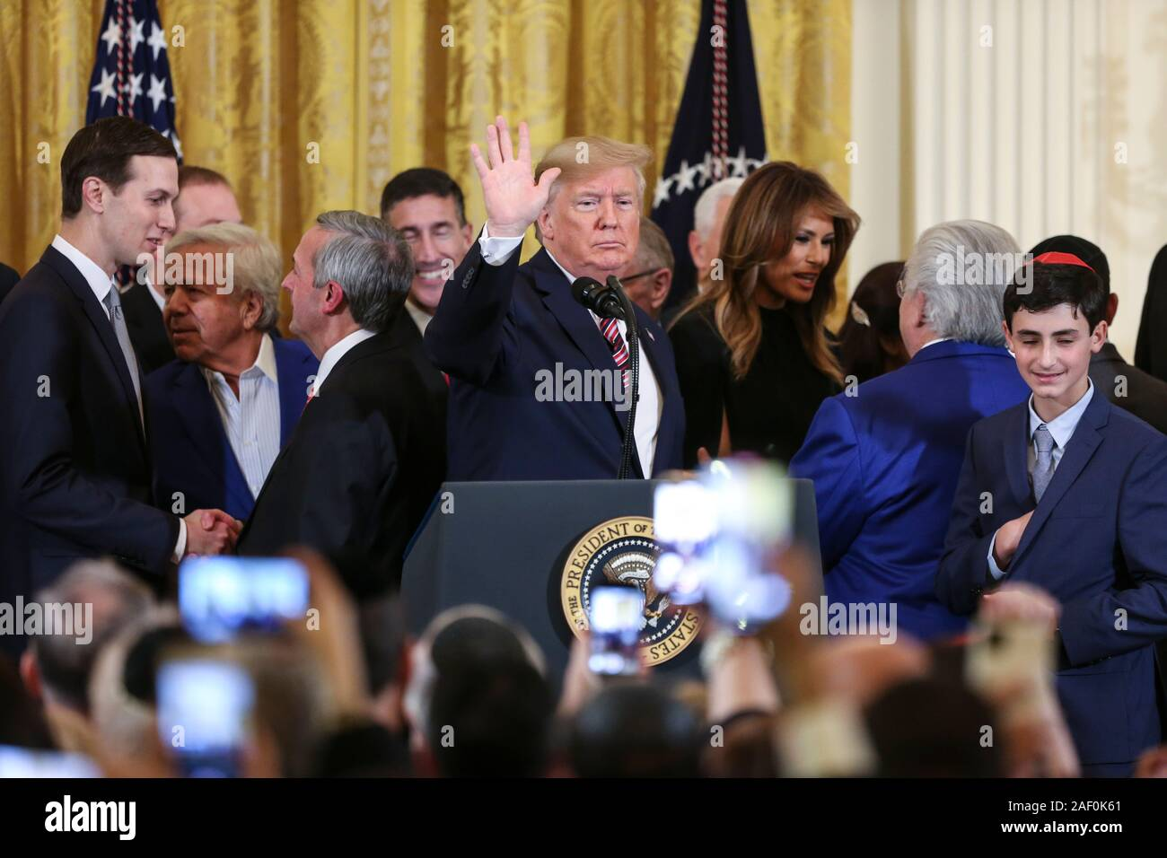 Washington, USA. 11th Dec, 2019. President Donald Trump gestures after he delivered remarks during a Hanukkah Reception on December 11, 2019 in Washington, DC. (Photo by Oliver Contreras/SIPA USA) Credit: Sipa USA/Alamy Live News Stock Photo
