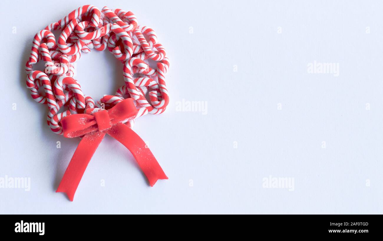 Red And White Multiple Candy Cane Wreath With A Red Bow Laying On A White Background With Copy Space Stock Photo Alamy
