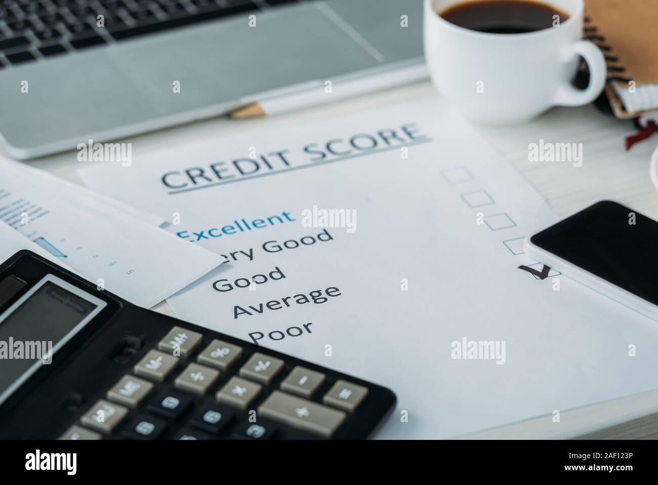 Selective Focus Of Smartphone Cup With Coffee Calculator Laptop And Credit Score Stock Photo Alamy