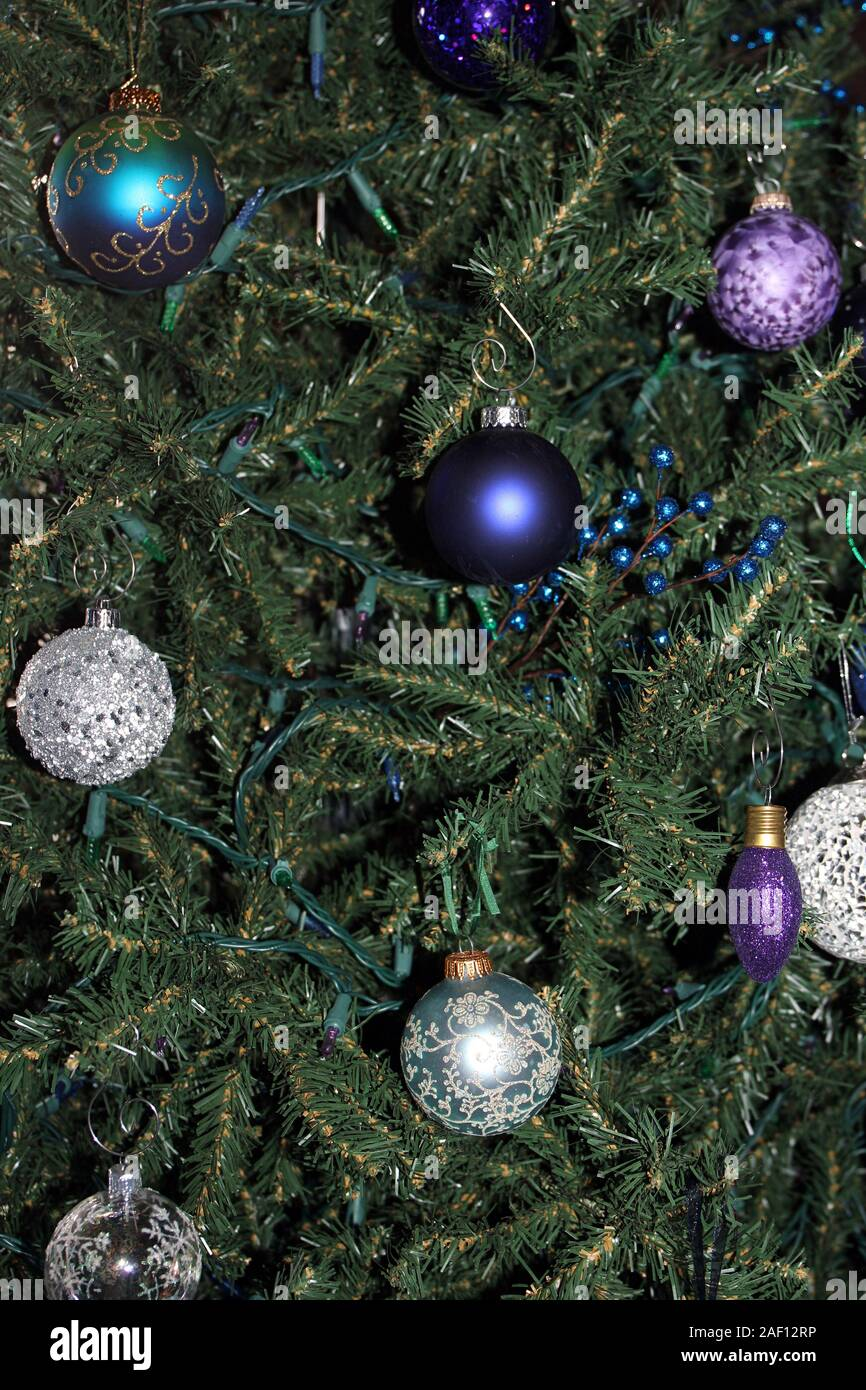 Close Up Of Various Blue Silver And Purple Ornaments On A Christmas Tree Stock Photo Alamy