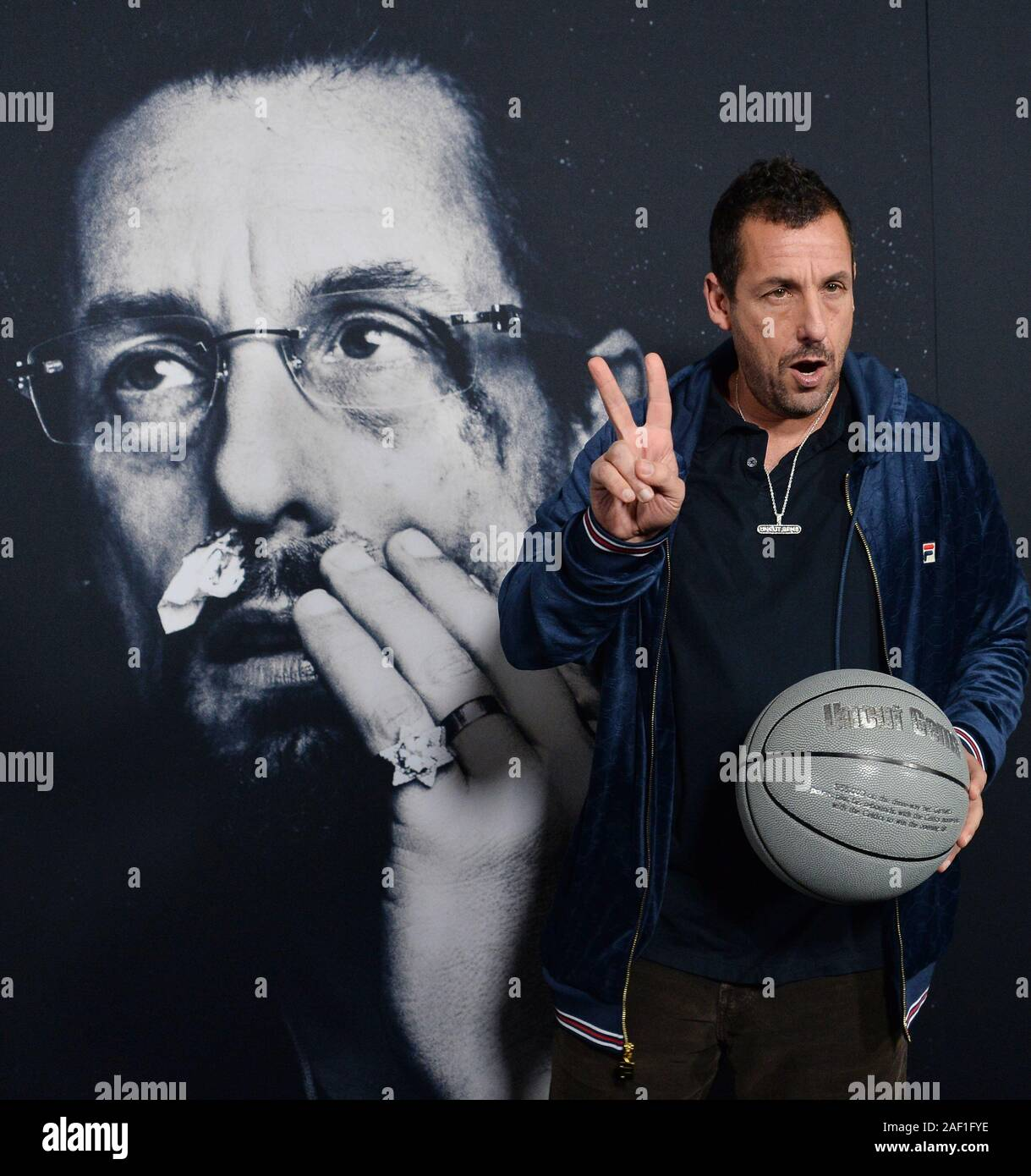 """Hollywood, California, USA. 12th Dec, 2019. Hollywood, California, USA. 11th Dec, 2019. Cast member Adam Sandler attends the premiere of the motion picture crime thriller """"Uncut Gems"""" at the ArcLight Cinema Dome in the Hollywood section of Los Angeles on Wednesday, December 11, 2019. Storyline: Howard Ratner (Adam Sandler), a charismatic New York City jeweler always on the lookout for the next big score. Credit: UPI/Alamy Live News Stock Photo"""
