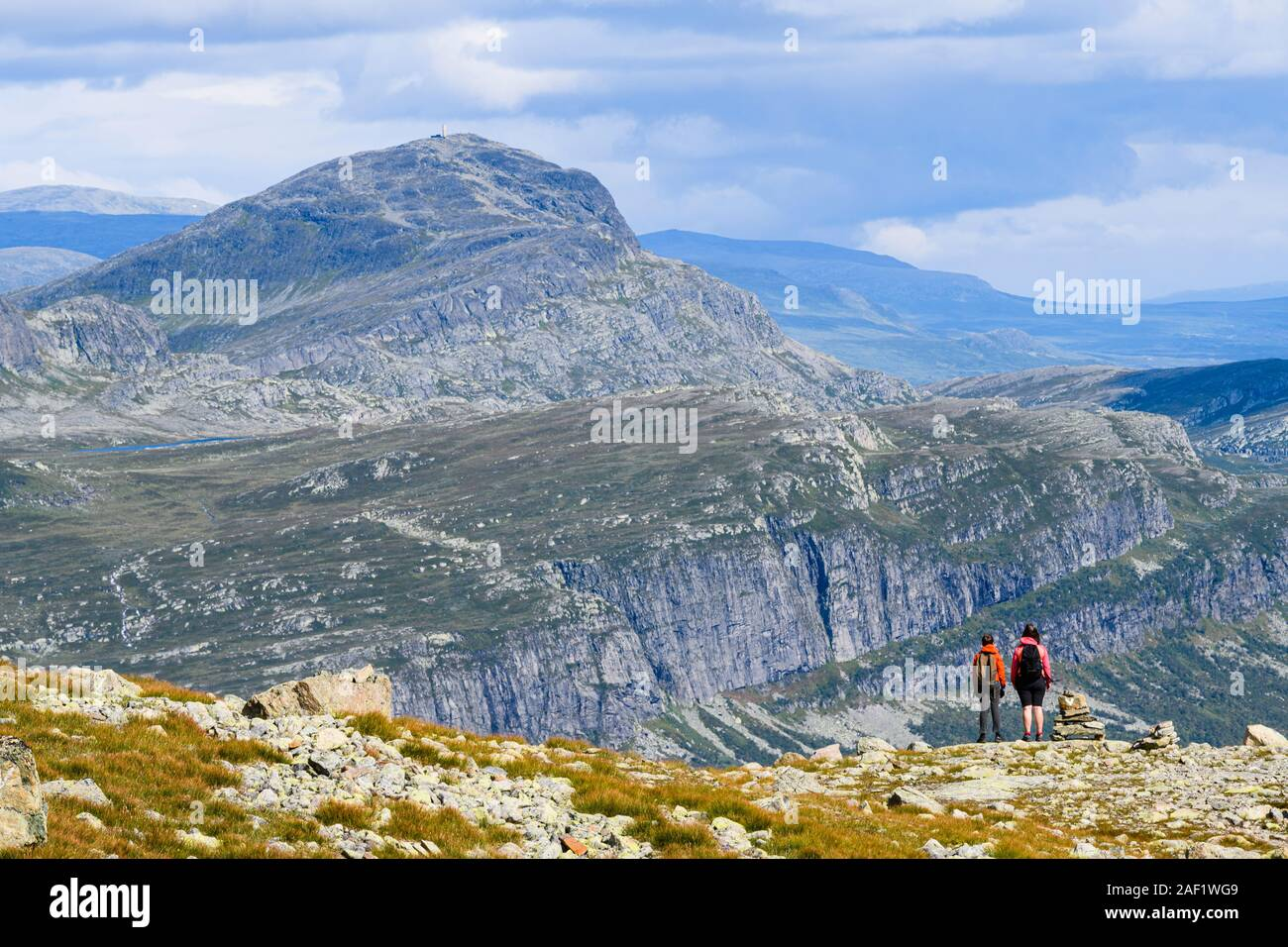 Hikers in mountains Stock Photo