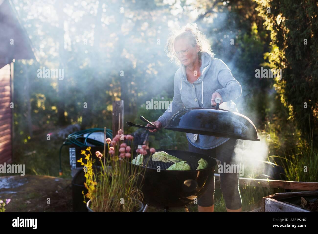 Woman having barbecue Stock Photo