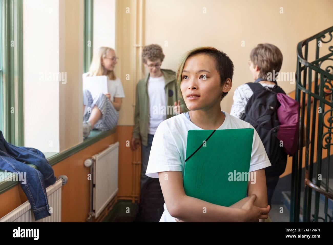 Teenage girl on corridor Stock Photo