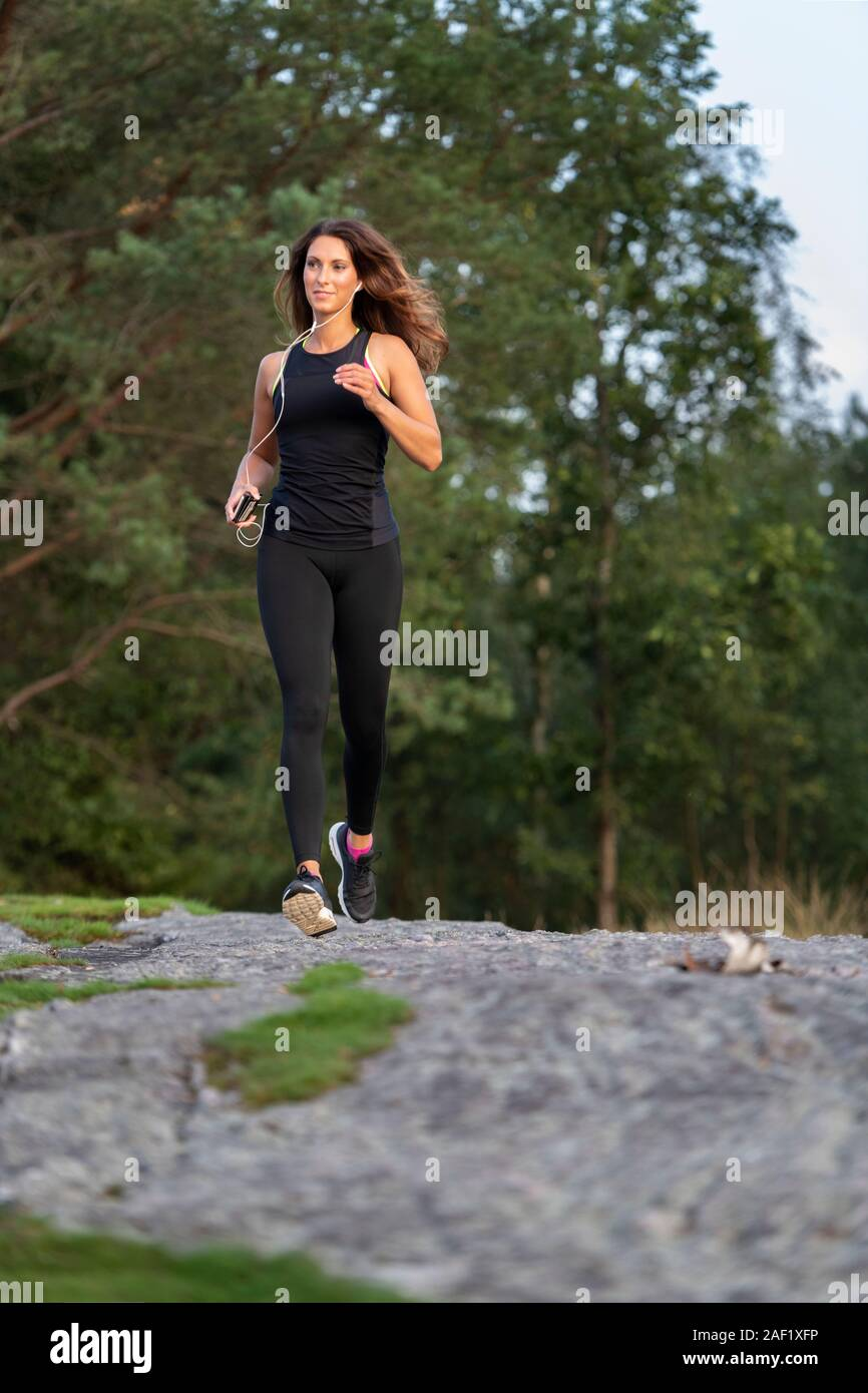 Woman jogging outside Stock Photo