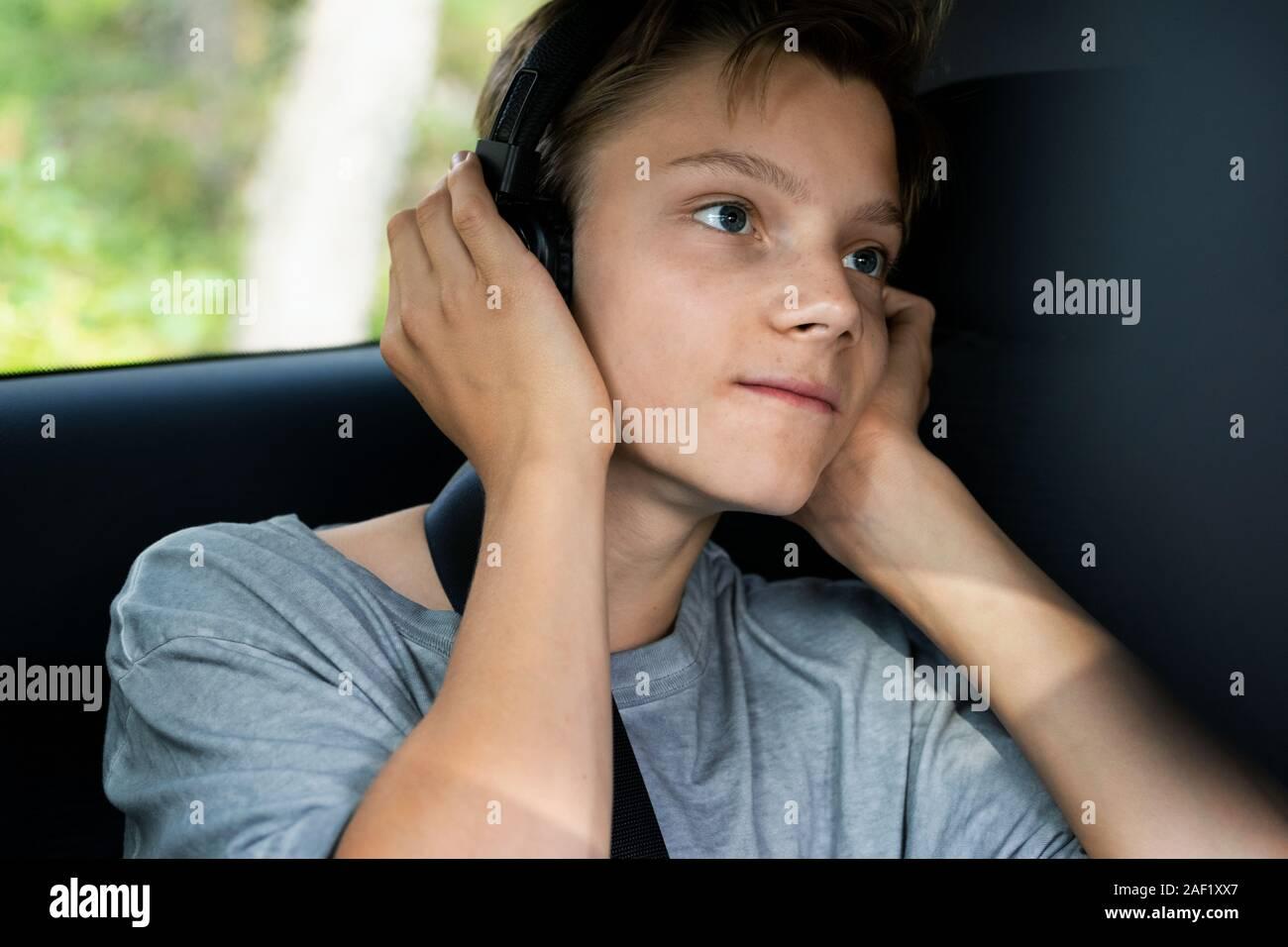 Boy in car listening music Stock Photo