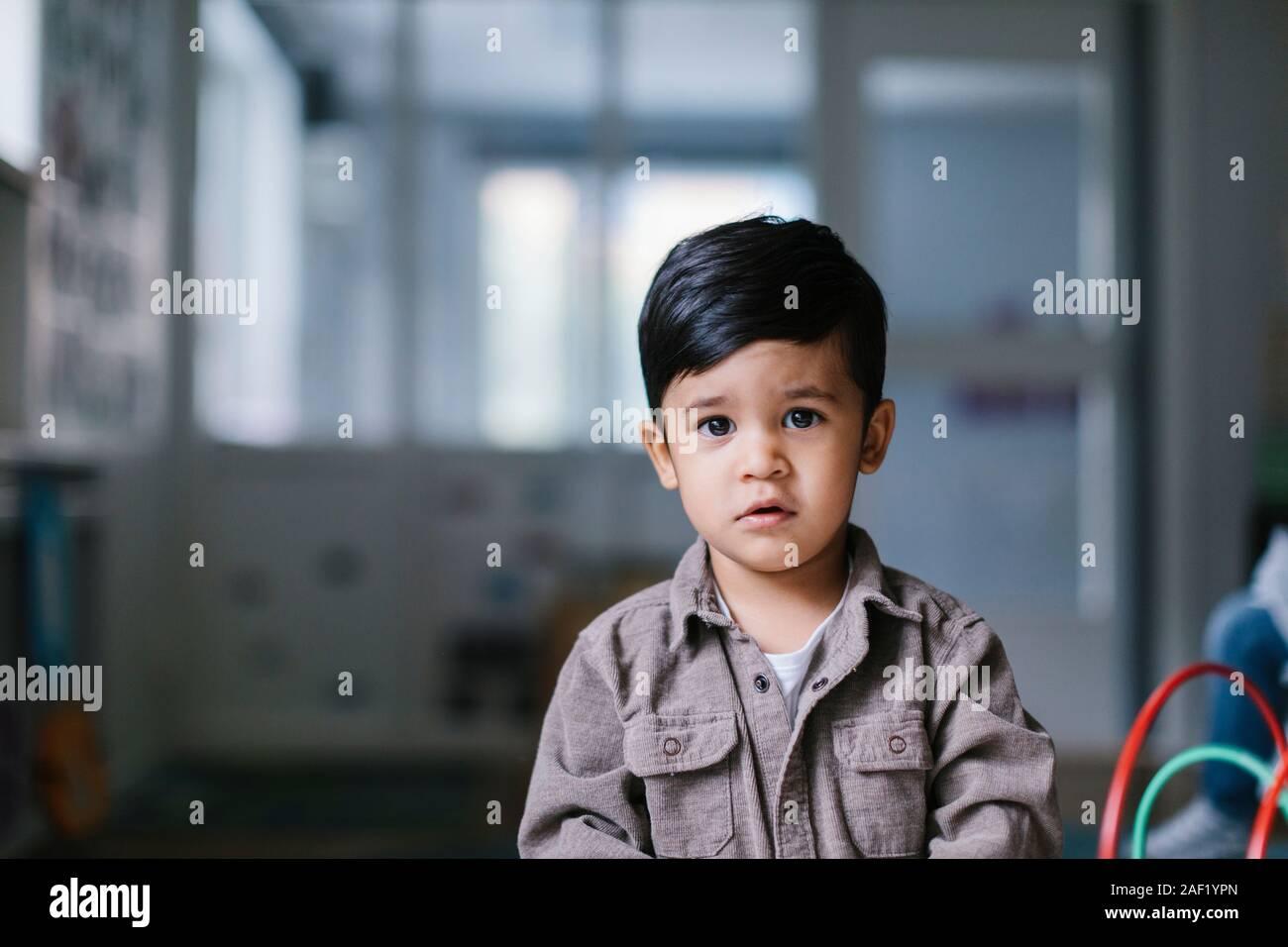 Boy looking at camera Stock Photo