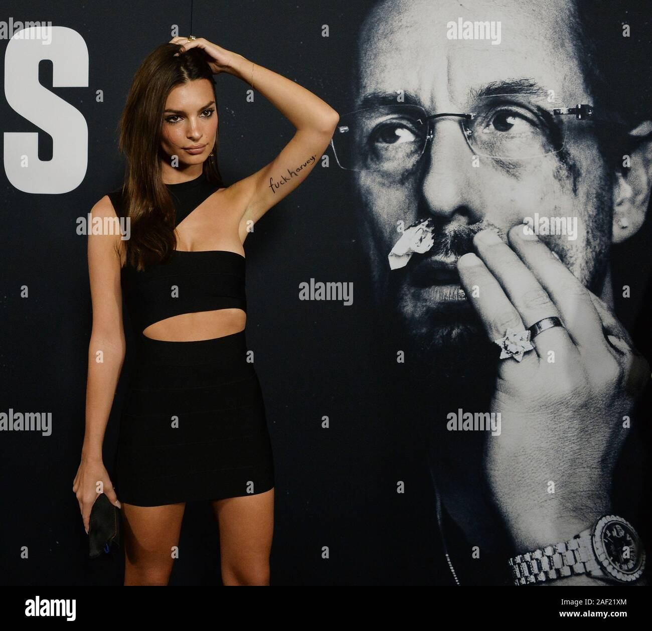 """Hollywood, California, USA. 12th Dec, 2019. Emily Ratajkowski attends the premiere of the motion picture crime thriller """"Uncut Gems"""" at the ArcLight Cinema Dome in the Hollywood section of Los Angeles on Wednesday, December 11, 2019. Storyline: Howard Ratner (Adam Sandler), a charismatic New York City jeweler always on the lookout for the next big score. Credit: UPI/Alamy Live News Stock Photo"""