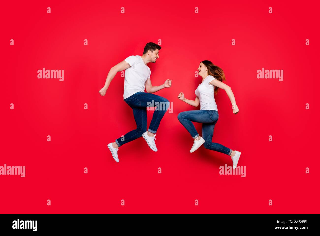 Side Profile Full Body Size Photo Of Cheerful Nice Cute Couple Of Girlfriend Boyfriend Bumping Into Each Other Smiling Running Jumping Jeans Denim Stock Photo Alamy
