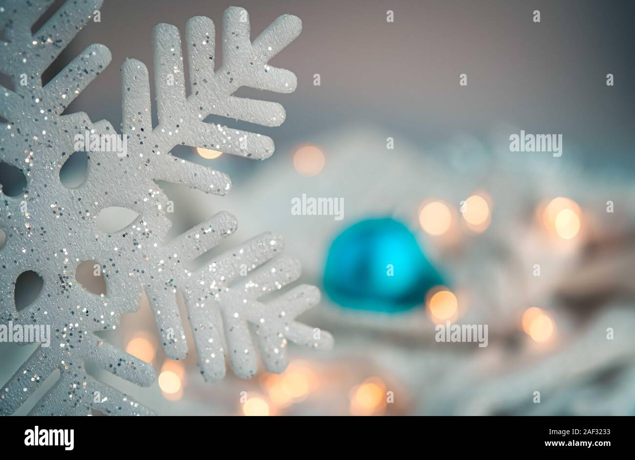 White And Blue Holiday Decorations On Silver Background Christmas Balls Candle And Fairy Lights Color Of The Year Concept Stock Photo Alamy