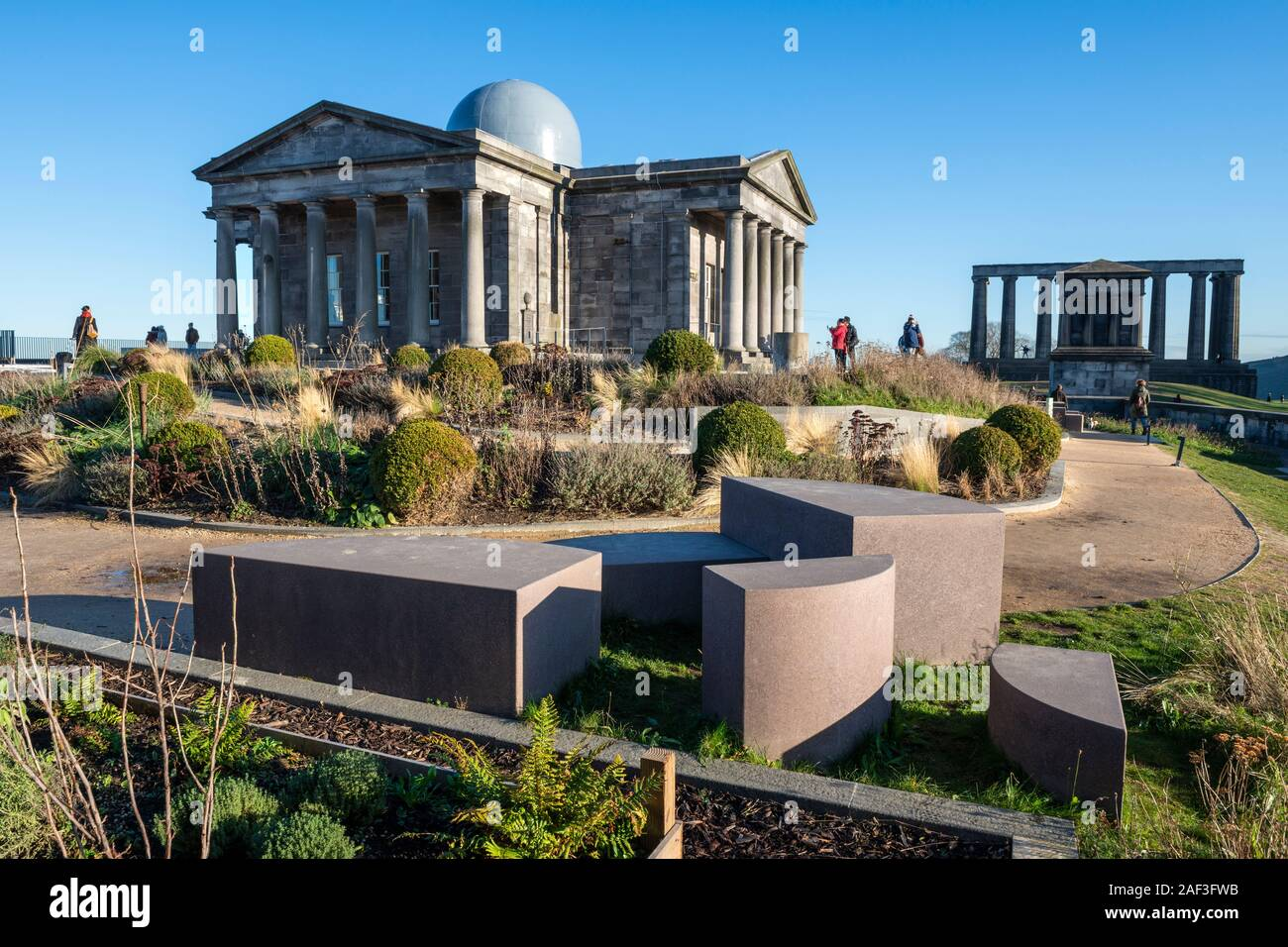 Restored City Observatory, now the Collective Arts Centre, with National Monument of Scotland in background on Calton Hill, Edinburgh, Scotland, UK Stock Photo