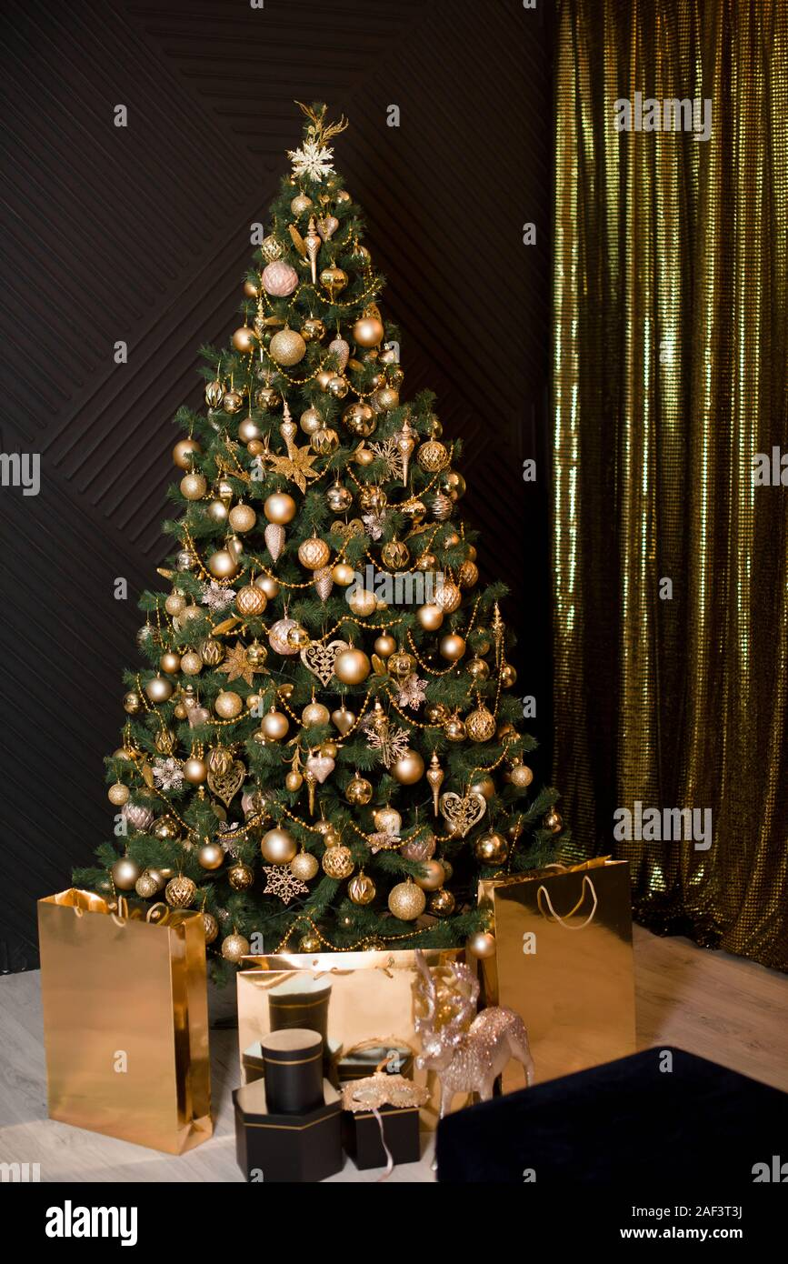 Christmas Decorations 2020 Gifts Lights Beautiful Christmas tree, decorated with golden toys and lights