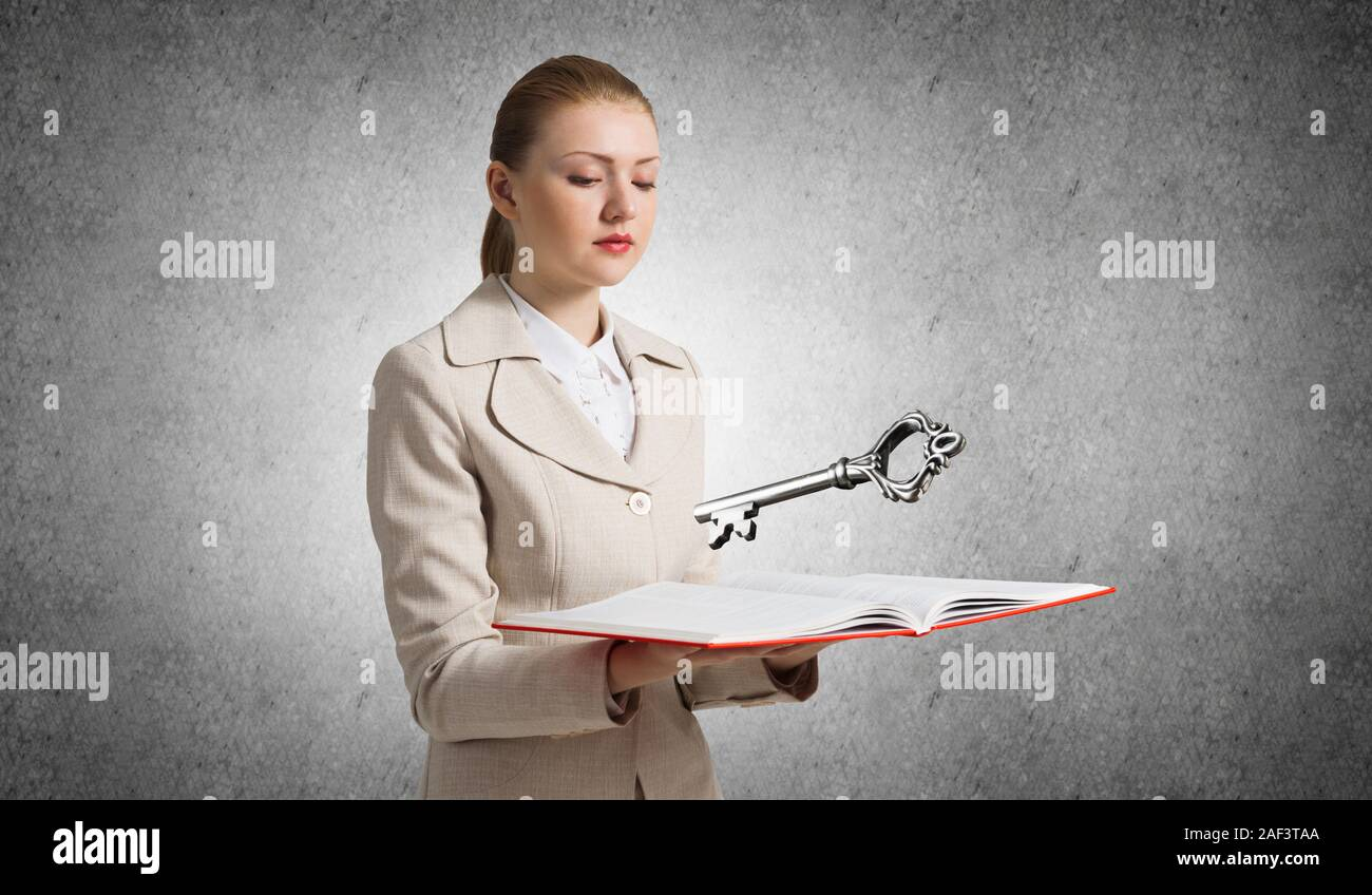 Woman Showing Big Metal Key Above Opened Book Real Estate Agency Advertising Sale And Rent Commercial And Private Real Property Elegant Consultant Stock Photo Alamy