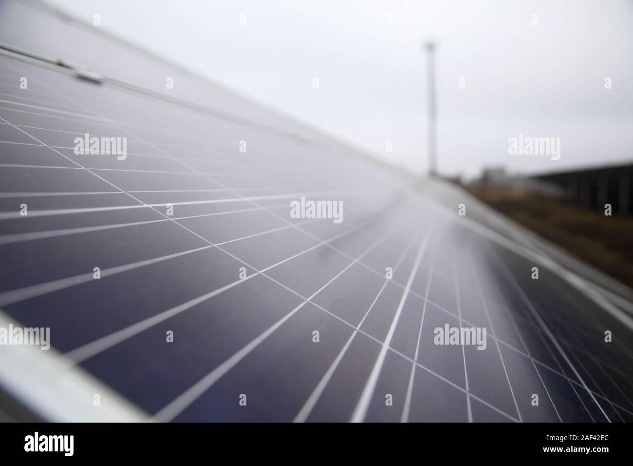 Installation of solar panels. Solar panel produces green, environmentally friendly energy from the sun.  Installation of solar panels in rural areas. Stock Photo