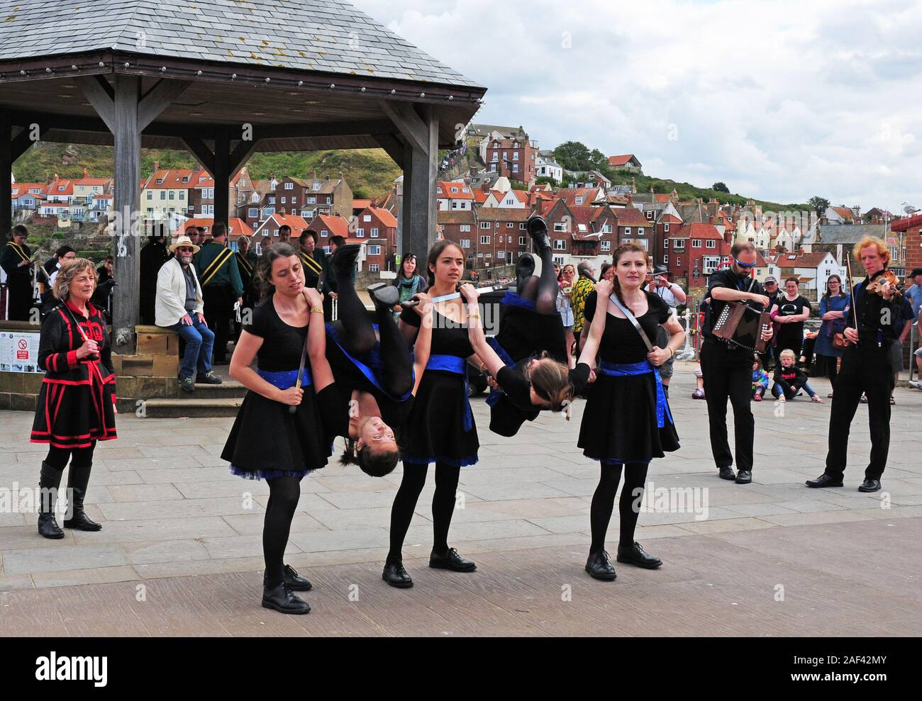 Women's Rapper Sword Team, The Tower Ravens performing at Whitby Folk Week. Stock Photo