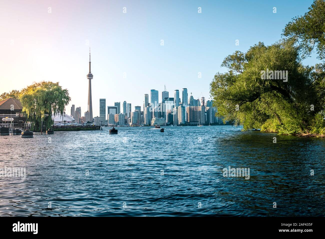View of CN Tower and Toronto skyline from Toronto Islands Park at sunset. Stock Photo