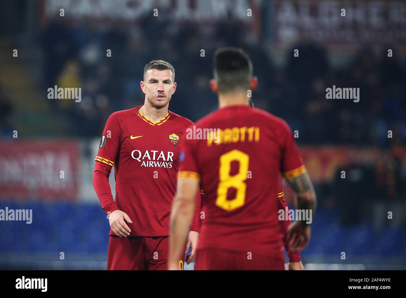 Edin Dzeko of Roma celebrates with Diego Perotti after scoring 2-1 goal during the UEFA Europa League, Group J football match between AS Roma and Wolfsberg AC on December 12, 2019 at Stadio Olimpico in Rome, Italy - Photo Federico Proietti/ESPA-Imaes Stock Photo