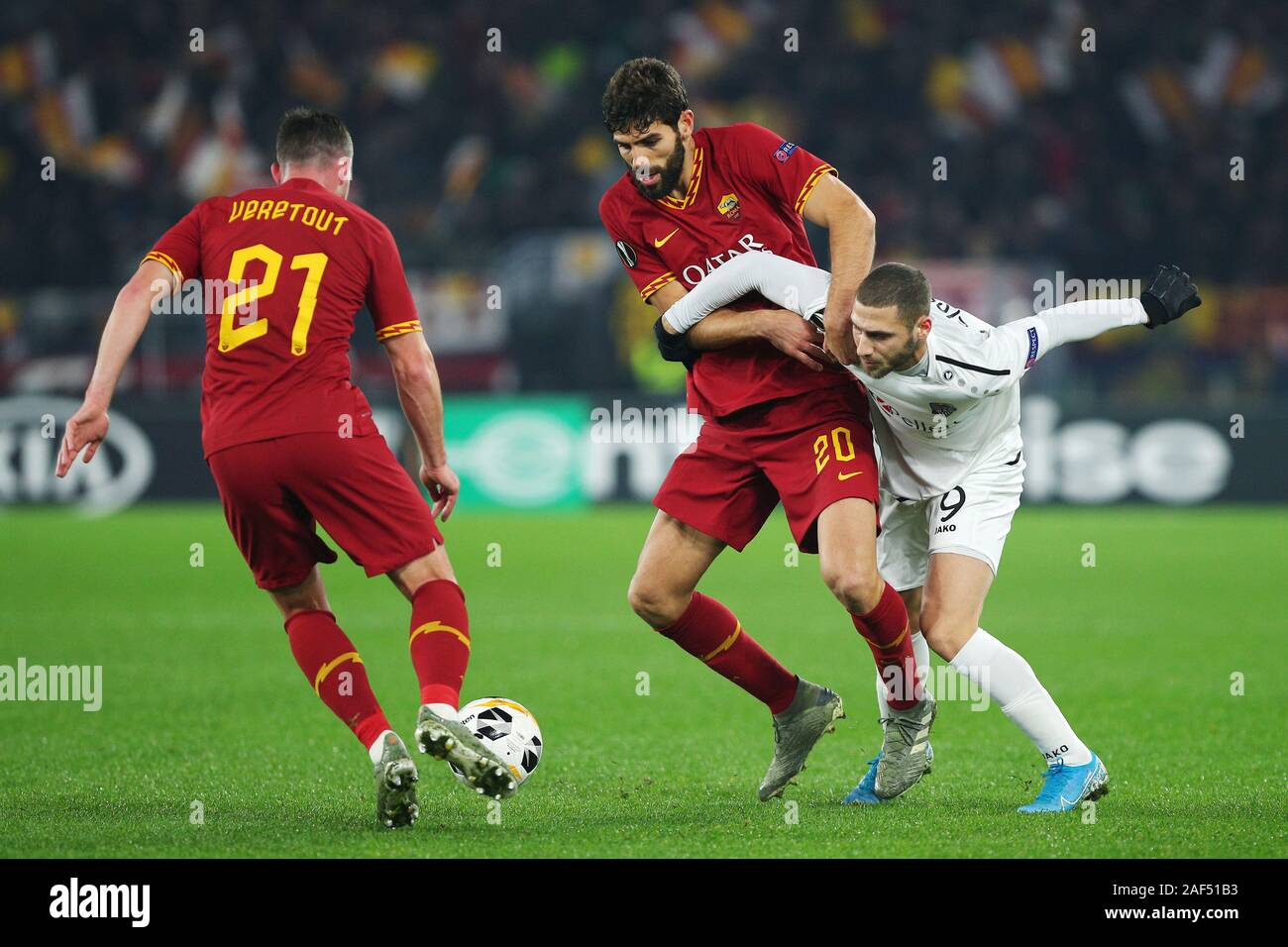 Federico Fazio of Roma (C), Jordan Veretout of Roma (L) and Shon Weissman of Wolfsberg (R) in action during the UEFA Europa League, Group J football match between AS Roma and Wolfsberg AC on December 12, 2019 at Stadio Olimpico in Rome, Italy - Photo Federico Proietti/ESPA-Images Stock Photo