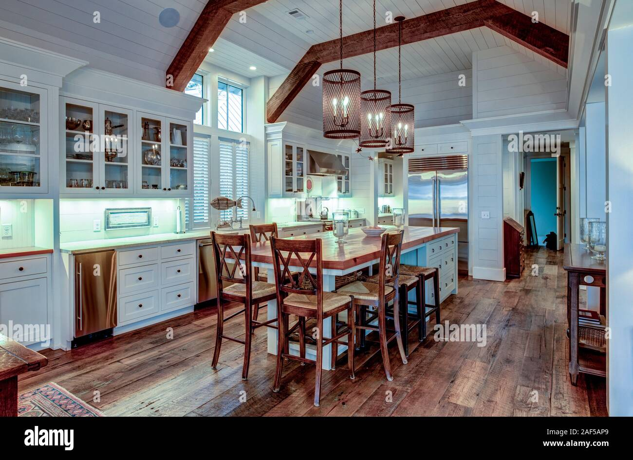Large Expensive Chefs Kitchen In Luxury Home With Rough Hewn Wood