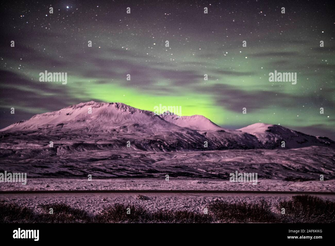 Northern lights over the mountain in Reykjavik Iceland, Aurora Polaris, also know as Northern Lights Aurora Borealis, Stock Photo